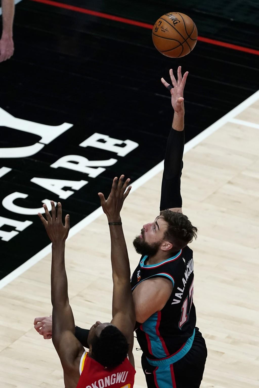 Memphis Grizzlies center Jonas Valanciunas (17) shoots over Atlanta Hawks forward Onyeka Okongwu (17) in the first half of an NBA basketball game Wedn...