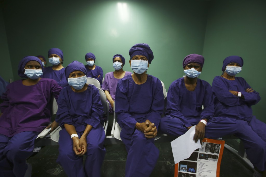 """Nepalese patients wait to receive anesthesia before eye surgery at the Tilganga Eye Center in Kathmandu, Nepal, Friday, March 26, 2021. Nepal's """"God o..."""