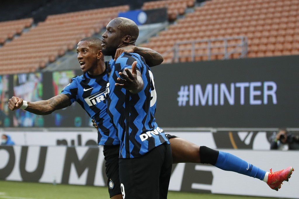 Inter Milan's Romelu Lukaku, right, celebrates with his teammate Ashley Young, after scores against Sassuolo during the Serie A soccer match between I...