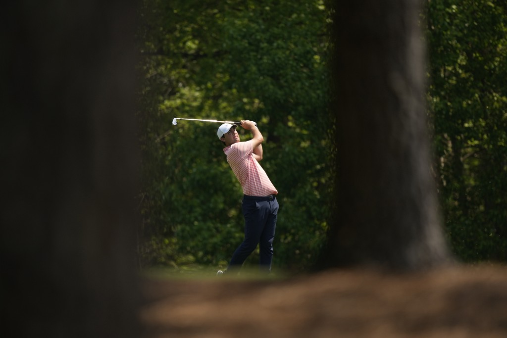 Scottie Scheffler hits on the 11th fairway during a practice round for the Masters golf tournament on Wednesday, April 7, 2021, in Augusta, Ga. (AP Ph...