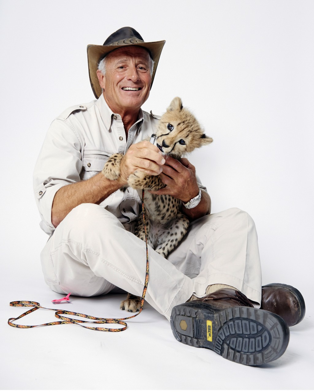 FILE - Wildlife advocate Jack Hanna poses for a portrait with a cheetah cub in New York on Oct. 12, 2015. The family of celebrity zookeeper and TV sho...