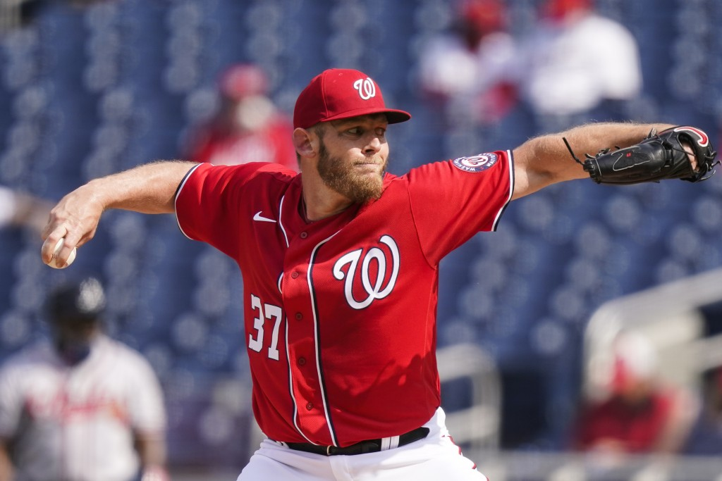 Washington Nationals starting pitcher Stephen Strasburg throws during the first inning of the second baseball game of a doubleheader against the Atlan...