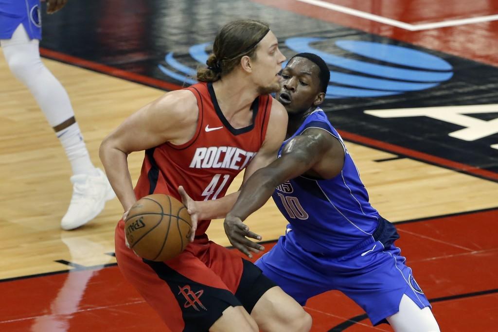 Houston Rockets forward Kelly Olynyk (41) avoids the reach in by Dallas Mavericks forward Dorian Finney-Smith (10) during the first half of an NBA bas...