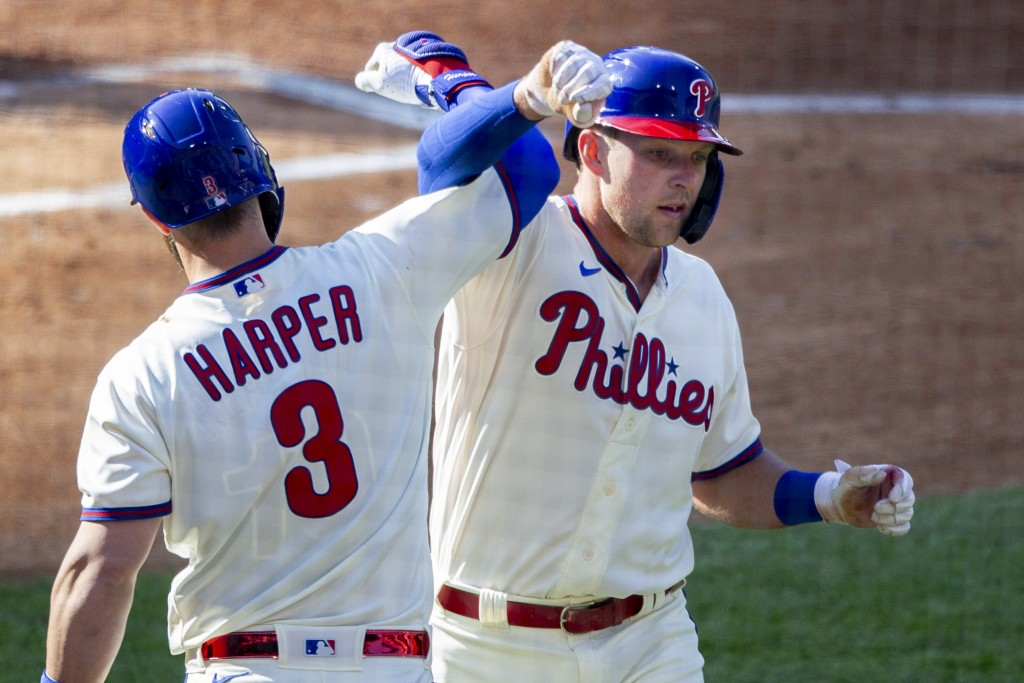 Philadelphia Phillies Rhys Hoskins, right, is congratulated by Bryce Harper (3) after he hit a home run during the first inning of a baseball game, We...