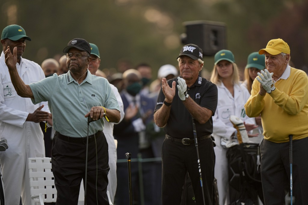 Gary Player, center, and Jack Nicklaus applaud as Lee Elder, left, waves before the ceremonial first tee shot at the Masters golf tournament on Thursd...