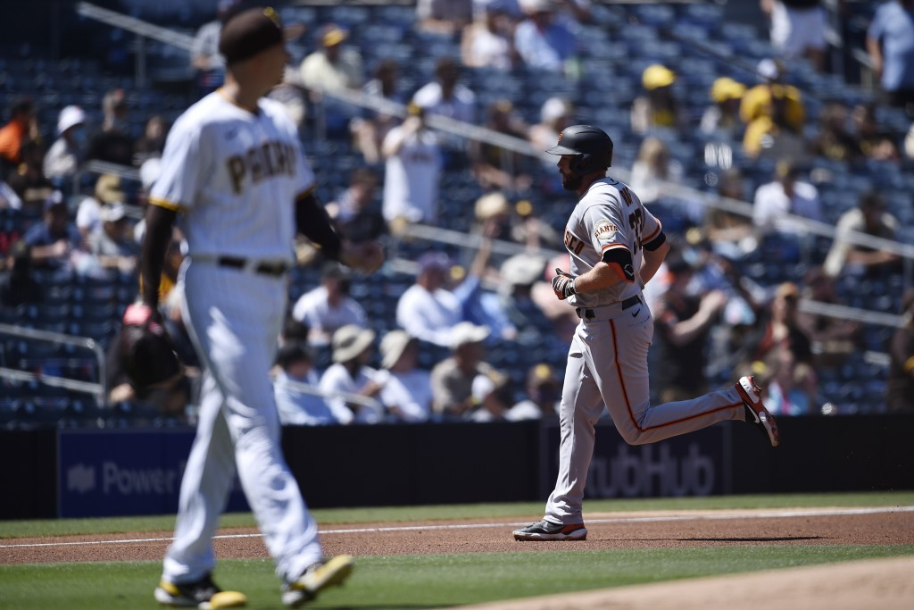 San Francisco Giants' Darin Ruf, right, rounds the bases after hitting a two-run home run off of San Diego Padres starting pitcher Blake Snell during ...