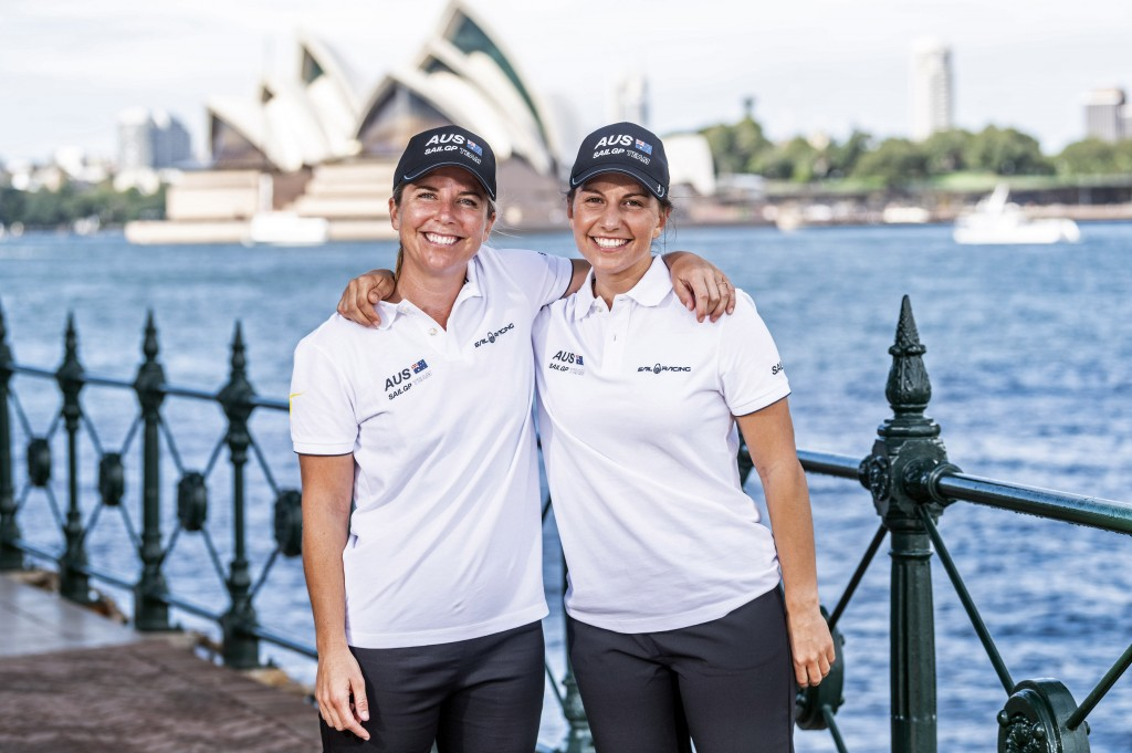 In this photo provided by SailGP are Nina Curtis, left, and Lisa Darmanin at Sydney Harbour in Australia on Wednesday, April 7, 2021. Four years ago, ...