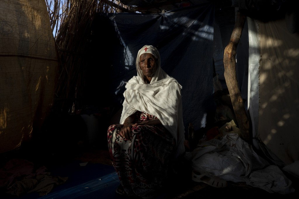 """Tigrayan refugee Maza Girmay, 65, sits in her shelter, in Hamdayet, eastern Sudan, near the border with Ethiopia, on March 15, 2021. """"I heard food was..."""