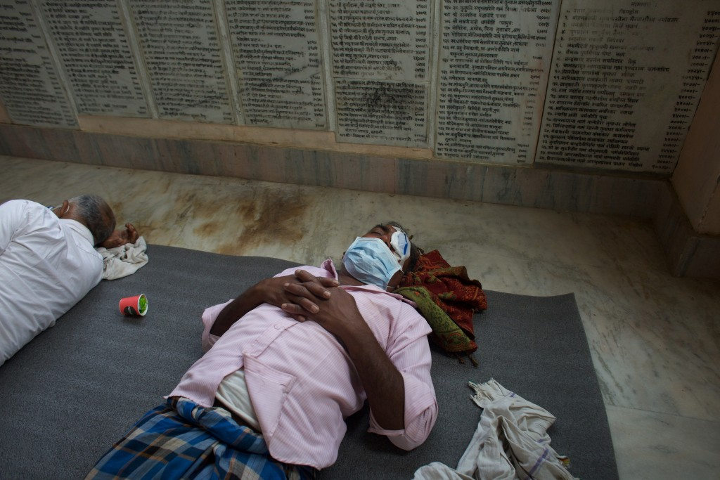 A patient takes a rest after cataract surgery at an eye camp in Lumbini, 288 kilometers (180 miles) south west of Kathmandu, Nepal, March 31, 2021. Ne...