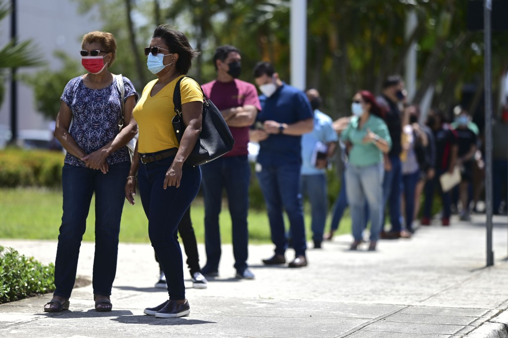 People line up outside the Miramar Convention Center for the first mass vaccination event carried out by the Department of Health and the Voces nonpro...
