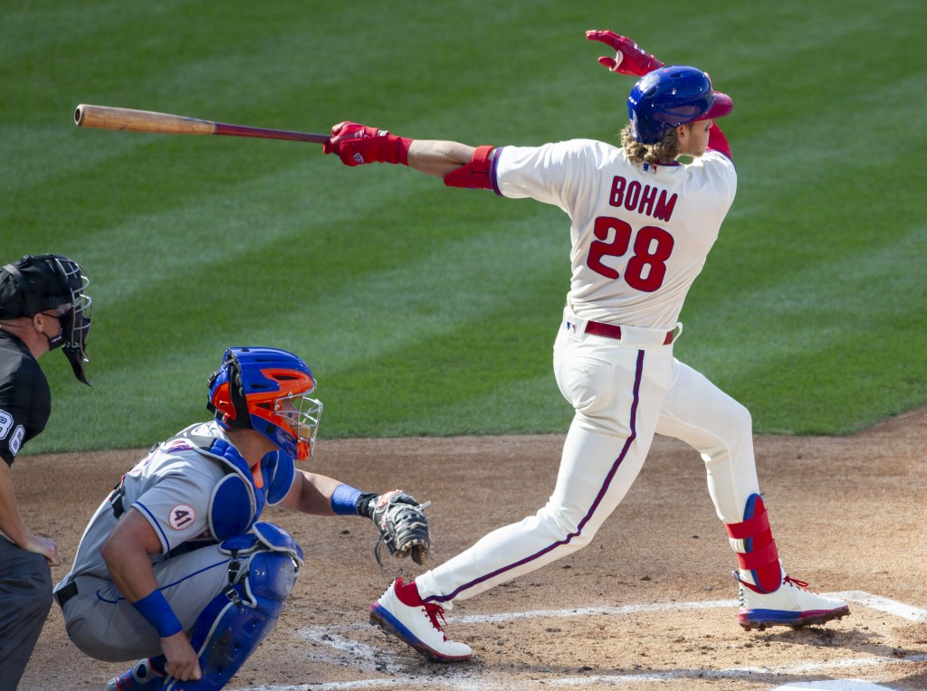 Philadelphia Phillies Alec Bohm (28) follows through on a home run during the first inning of a baseball game against the New York Mets, Wednesday, Ap...