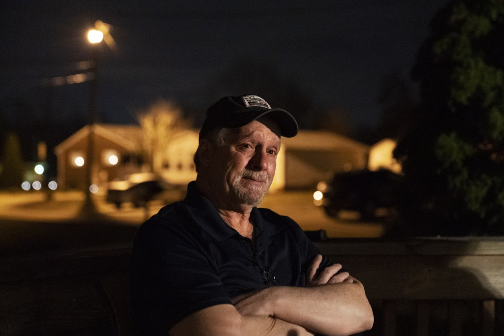 Jeff Carter, left, becomes emotional as he remembers his daughter, Kayla, while sitting outside his home, Tuesday, March 16, 2021, in Milton, W.Va. Ka...