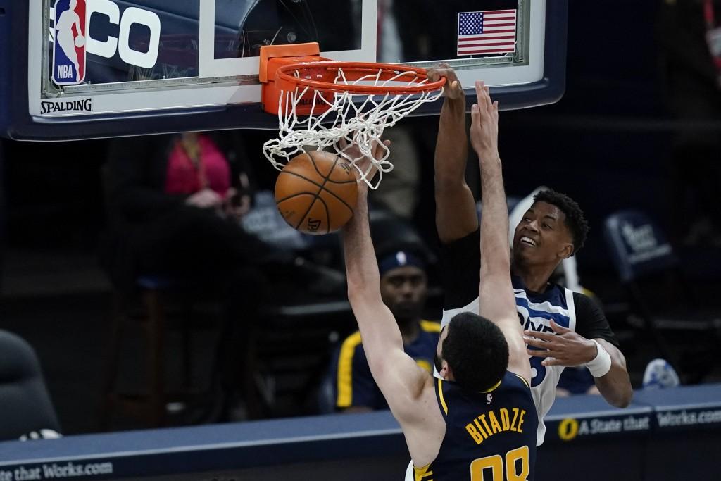 Minnesota Timberwolves' Jarrett Culver (23) dunks against Indiana Pacers' Goga Bitadze (88) during the second half of an NBA basketball game, Wednesda...