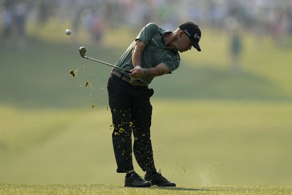 Brian Harman hits from the first fairway during the first round of the Masters golf tournament on Thursday, April 8, 2021, in Augusta, Ga. (AP Photo/M...