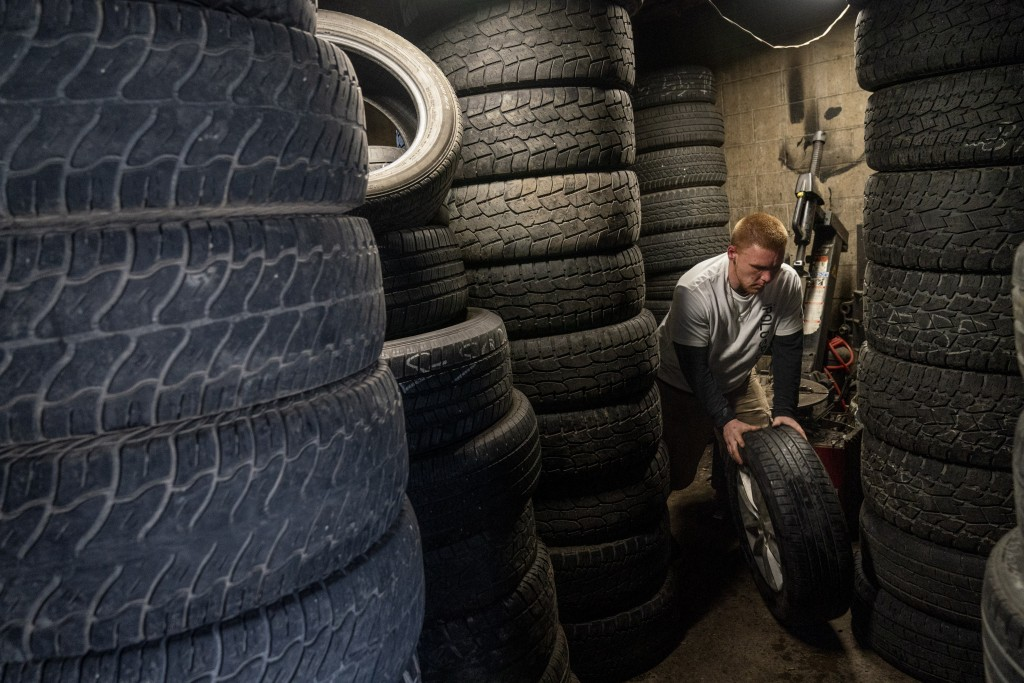 Steven Ash, 33, works at the tire shop his family owns in Huntington, W.Va., Wednesday, March 17, 2021, and where he overdosed just days before. Ash w...