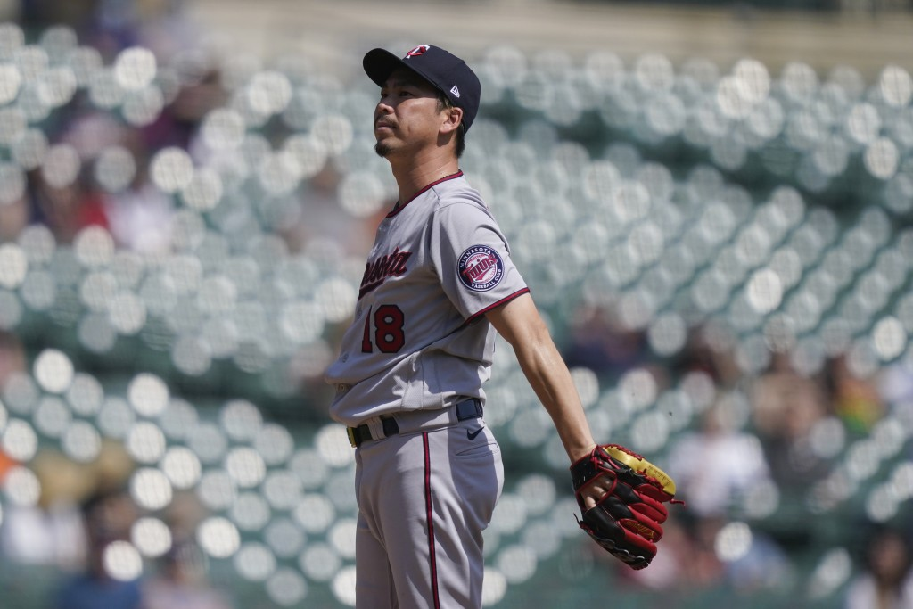 Minnesota Twins starting pitcher Kenta Maeda reacts after giving up a solo home run to Detroit Tigers' Wilson Ramos during the fifth inning of a baseb...