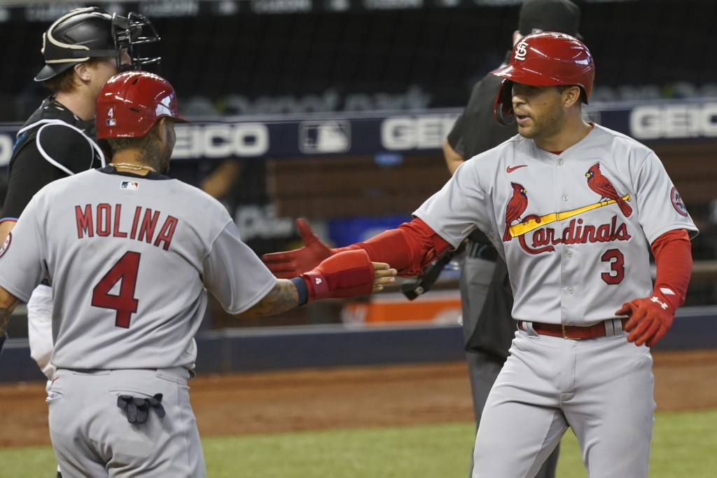 St. Louis Cardinals Yadier Molina (4) congratulates Dylan Carlson (3) after Carlson hit a grand slam in the ninth inning of a baseball game against th...