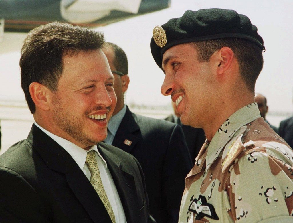 FILE - In this April 2, 2001, file photo, Jordan's King Abdullah II laughs with his half brother Prince Hamzah, right, shortly before the monarch emba...
