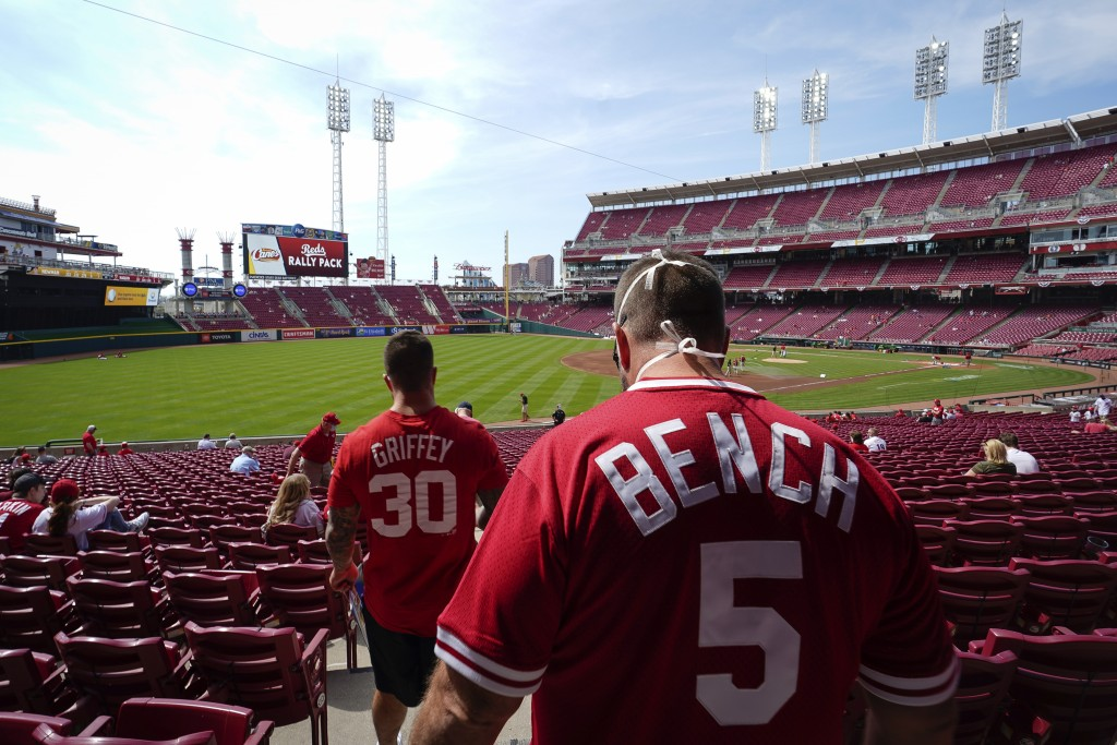 Cincinnati fans find their seats at Great American Ball Park before a baseball game between the Cincinnati Reds and the Pittsburgh Pirates in Cincinna...