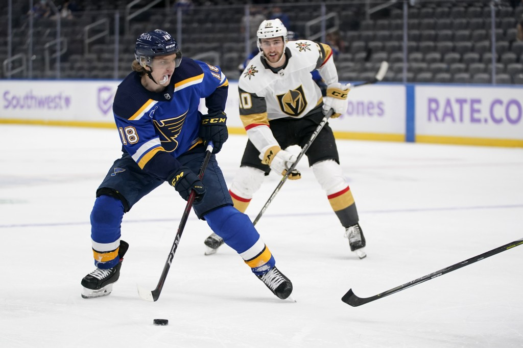 St. Louis Blues' Robert Thomas (18) looks for a shot as Vegas Golden Knights' Nicolas Roy (10) defends during the second period of an NHL hockey game ...