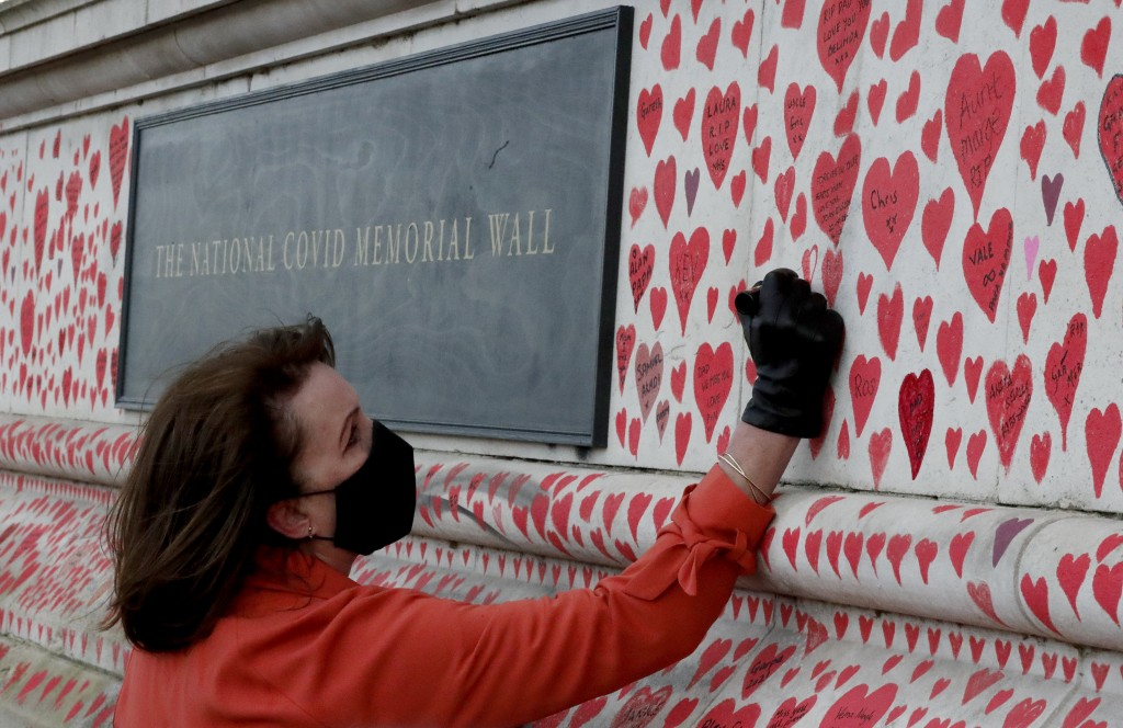 Fran Hall draws the last hearts as families bereaved by Covid-19 mark the completion of the approximately 150,000 hearts being painted onto the Nation...