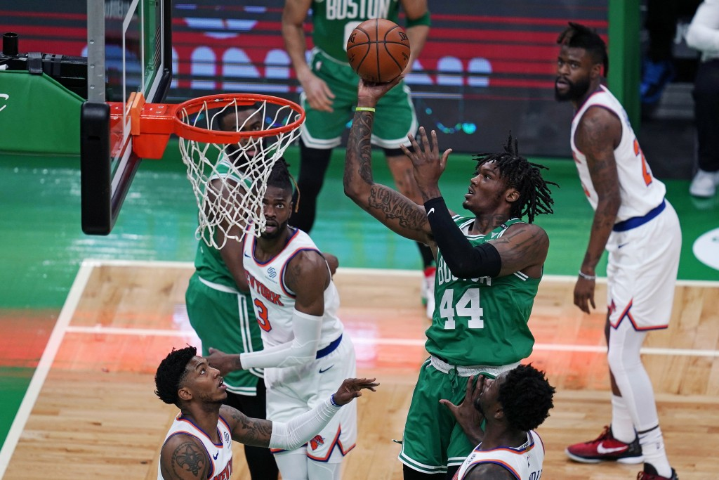 Boston Celtics center Robert Williams III (44) shoots against the New York Knicks during the first half of an NBA basketball game Wednesday, April 7, ...
