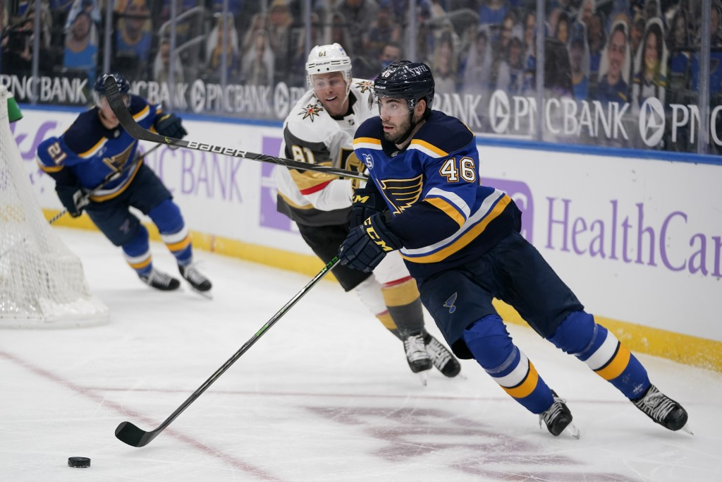 St. Louis Blues' Jake Walman (46) handles the puck as Vegas Golden Knights' Jonathan Marchessault (81) watches during the third period of an NHL hocke...