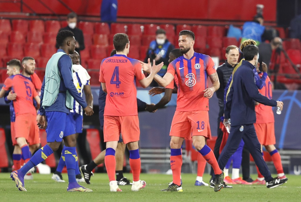 Chelsea players celebrate at the end of the Champions League, first leg, quarterfinal soccer match between FC Porto and Chelsea at the Ramon Sanchez-P...