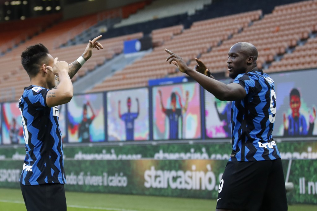 Inter Milan's Romelu Lukaku, right, celebrates with his teammate Lautaro Martinez after scores against Sassuolo during the Serie A soccer match betwee...