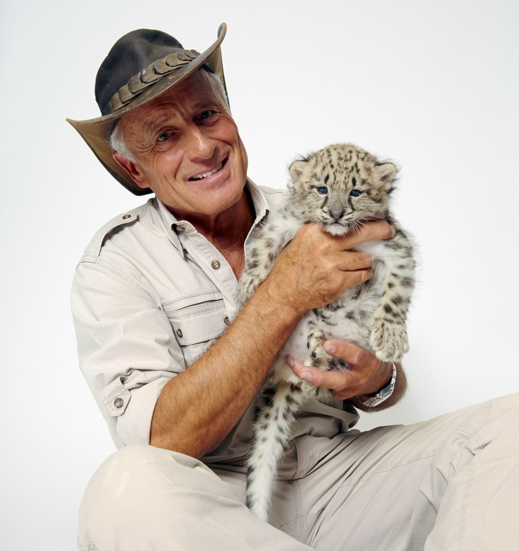 FILE - Wildlife advocate Jack Hanna poses for a portrait with a snow leopard cub in New York on Oct. 12, 2015. The family of celebrity zookeeper and T...