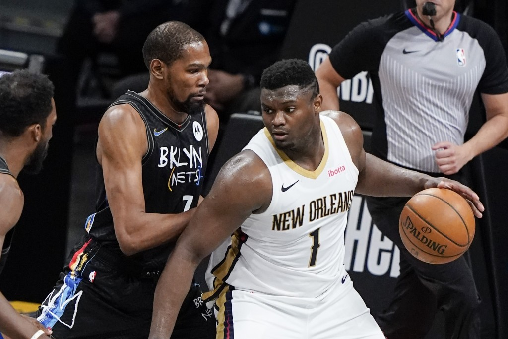 Brooklyn Nets' Kevin Durant (7) defends New Orleans Pelicans' Zion Williamson (1) during the first half of an NBA basketball game Wednesday, April 7, ...