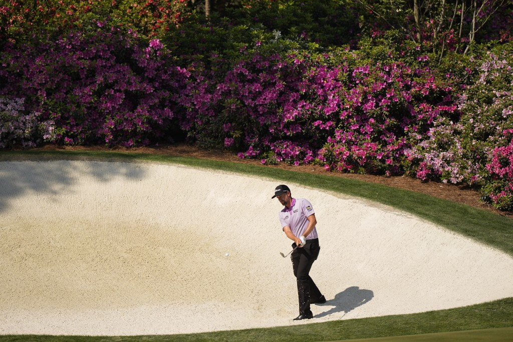 Webb Simpson hits out of a bunker at the 13th hole during a practice round for the Masters golf tournament on Wednesday, April 7, 2021, in Augusta, Ga...