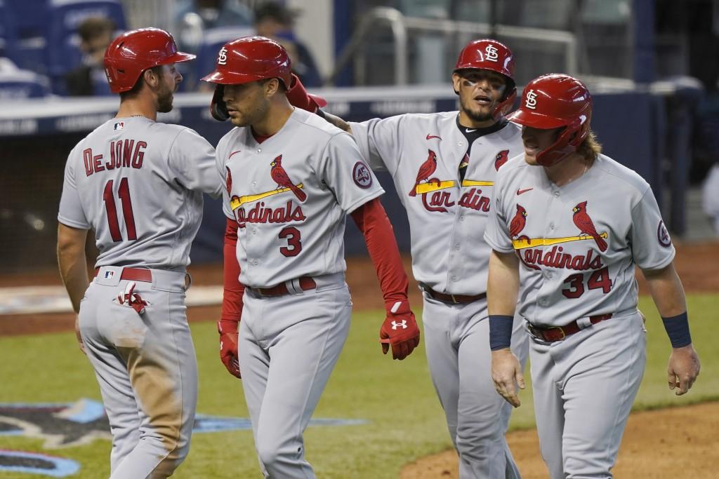 St. Louis Cardinals' John Nogowski (34), Yadier Molina (4) and Paul DeJong (11) congratulate Dylan Carlson (3) after Carlson hit a grand slam in the n...