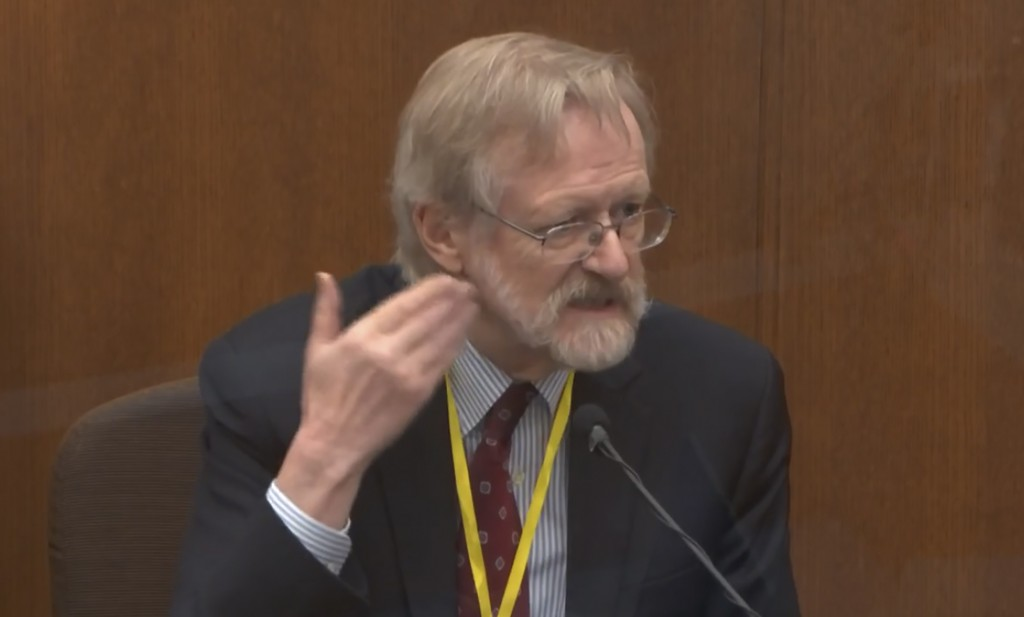 In this image from video, Dr. Martin Tobin testifies as Hennepin County Judge Peter Cahill presides Thursday, April 8, 2021, in the trial of former Mi...