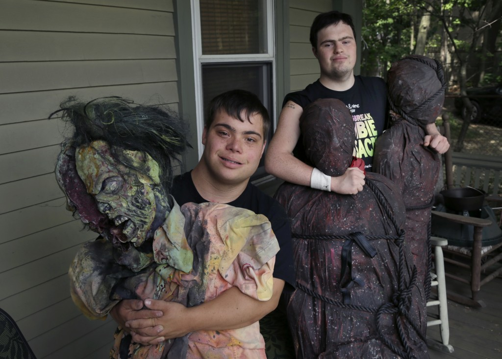 FILE — In this July 12, 2016, file photo, Sam Suchmann, right, and Mattie Zufelt pose with ghoulish figures at Sam's home in Providence, R.I. The two ...