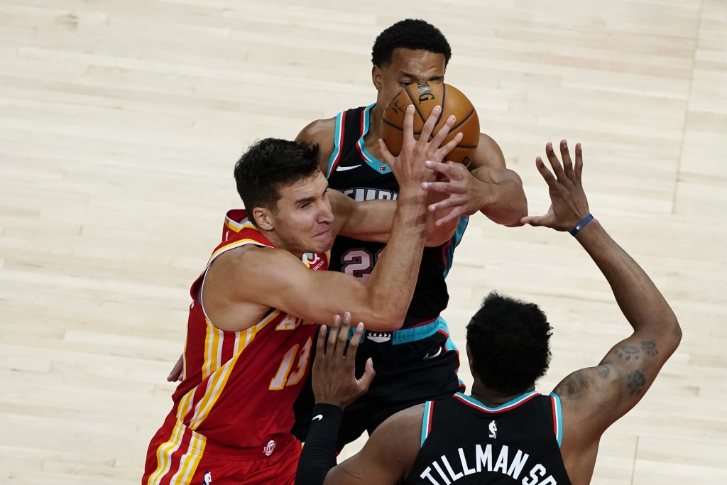 Atlanta Hawks guard Bogdan Bogdanovic (13) is defended by Memphis Grizzlies guard Desmond Bane (22) as he tries to shoot in the first half of an NBA b...
