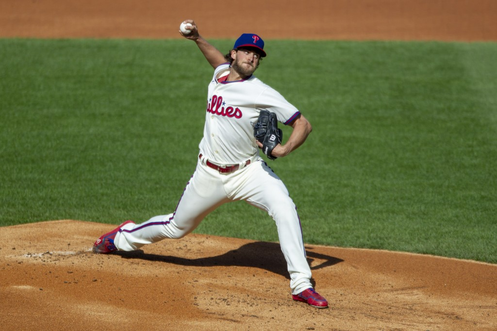 Philadelphia Phillies starting pitcher Aaron Nola (27) throws during the first inning of a baseball game against the New York Mets, Wednesday, April 7...