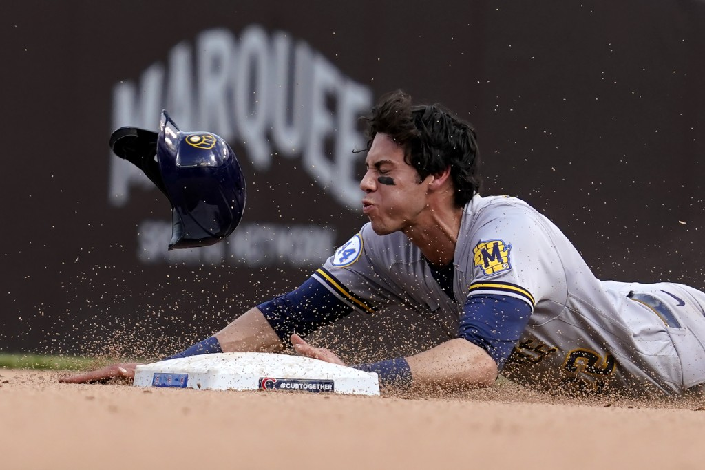 Milwaukee Brewers' Christian Yelich steals second base during the eighth inning of a baseball game against the Chicago Cubs in Chicago, Wednesday, Apr...
