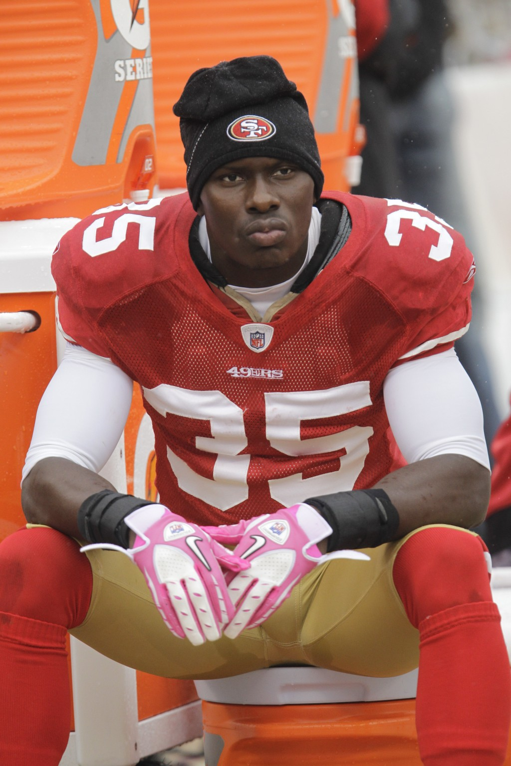 FILE - In this Oct. 17, 2010 file photo, San Francisco 49ers cornerback Phillip Adams (35) sits on the sideline during the first quarter of an NFL foo...