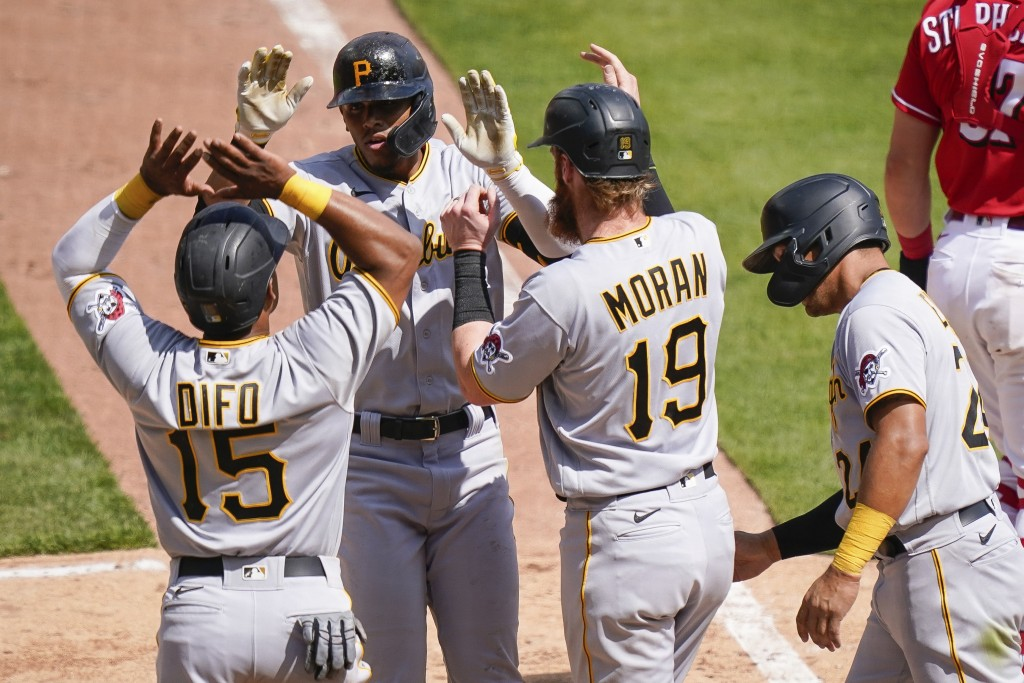 Pittsburgh Pirates' Erik Gonzalez, second from left, celebrates with teammates after hitting a grand slam during the ninth inning of a baseball game a...