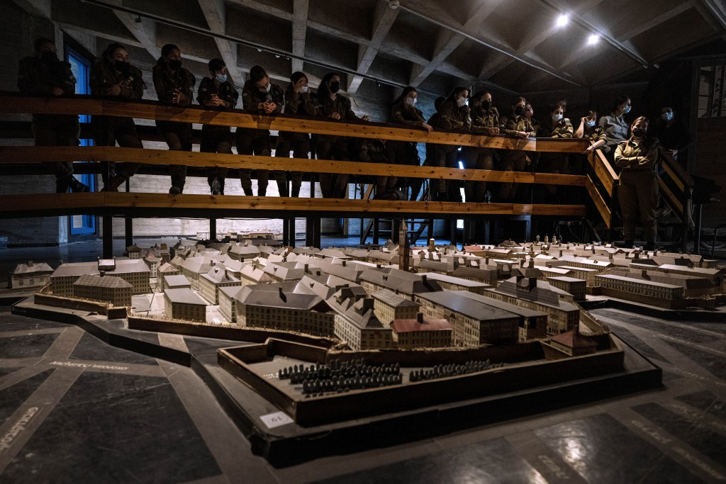 """Israeli soldiers look at a model of the Warsaw Ghetto at the museum """"From Holocaust to Revival"""" on the eve of Holocaust Remembrance Day, in Kibbutz Ya..."""