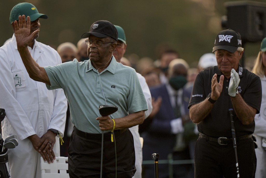 Lee Elder waves with Gary Player before the ceremonial first tee the first round of the Masters golf tournament on Thursday, April 8, 2021, in Augusta...