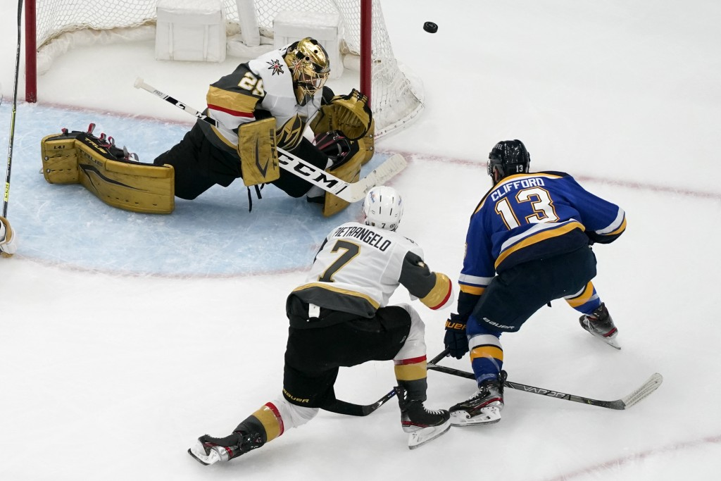 Vegas Golden Knights goaltender Marc-Andre Fleury (29) defects a shot from St. Louis Blues' Kyle Clifford (13) as Vegas Golden Knights' Alex Pietrange...