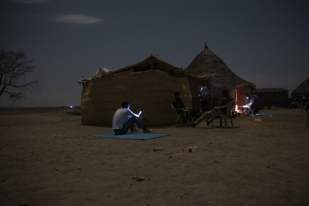 Tigrayan refugees who fled the conflict in the Ethiopia's Tigray try to find a network signal for their mobile phones in Hamdayet, eastern Sudan, near...