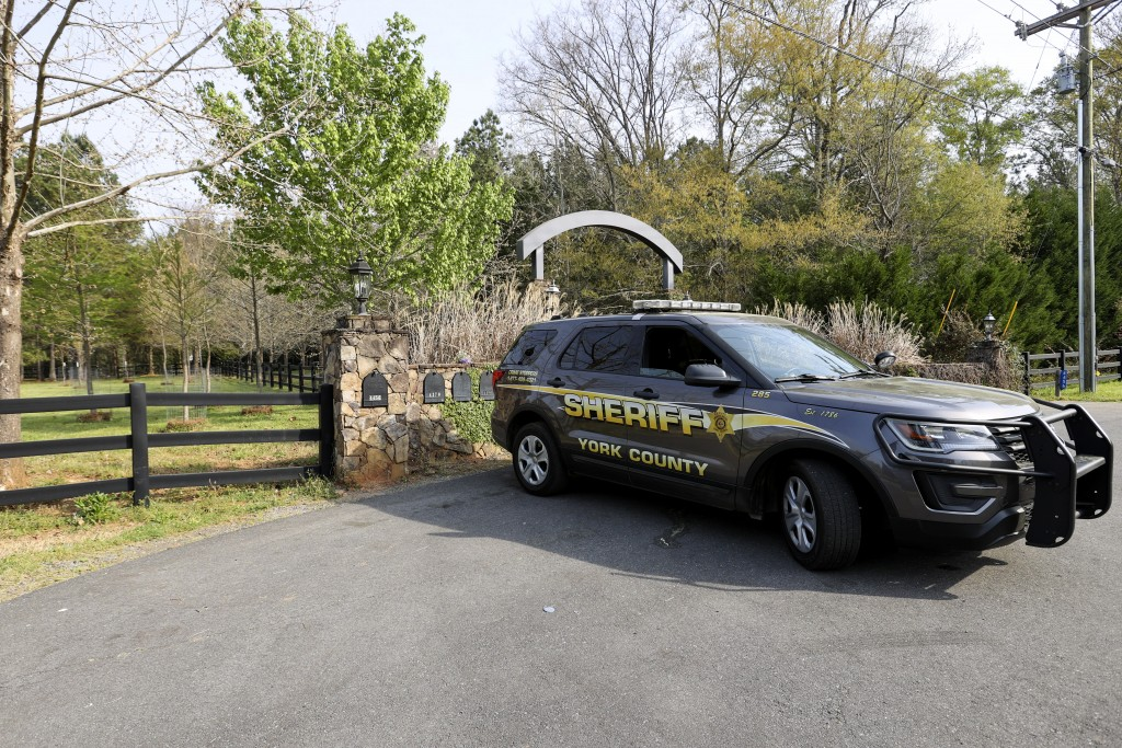 A York County sheriff's deputy is parked outside a residence where multiple people, including a prominent doctor, were fatally shot a day earlier, Thu...