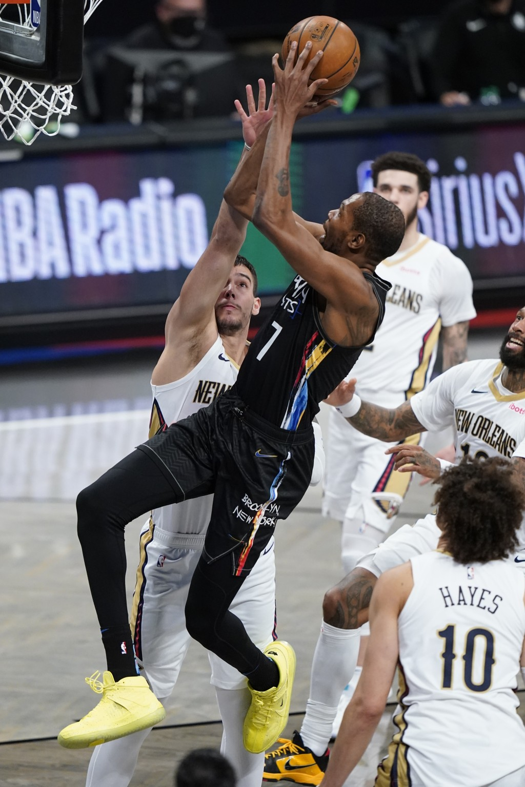 Brooklyn Nets' Kevin Durant (7) shoots over New Orleans Pelicans' Willy Hernangomez during the first half of an NBA basketball game Wednesday, April 7...