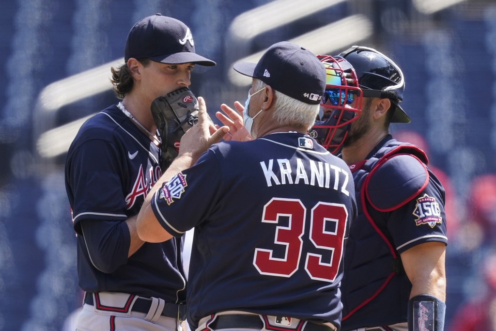 Atlanta Braves starting pitcher Max Fried, left, pitching coach Rick Kranitz and catcher Travis d'Arnaud talk on the mound during the first inning in ...