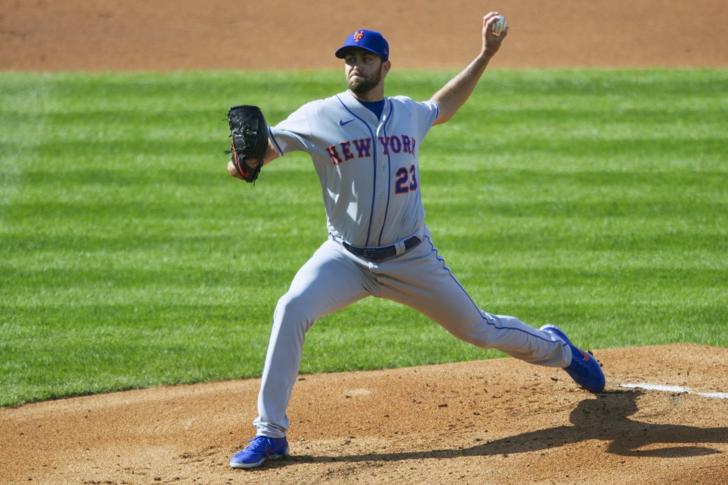 New York Mets starting pitcher David Peterson (23) throws during the first inning of a baseball game against the Philadelphia Phillies, Wednesday, Apr...