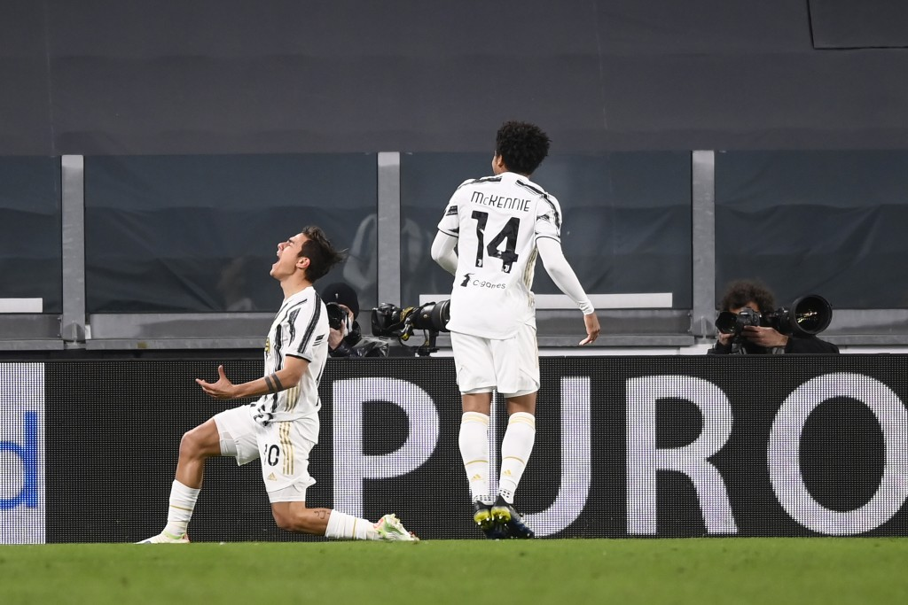 Juventus' Paulo Dybala celebrates after scoring his side's second goal during the Italian Serie A soccer match between Juventus and Napoli at the Alli...