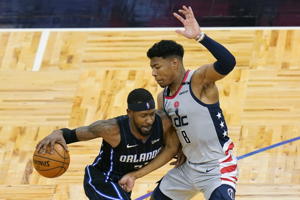Orlando Magic guard Terrence Ross, left, drives around Washington Wizards forward Rui Hachimura (8) during the second half of an NBA basketball game W...